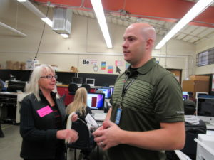 New Desk Top Publishing teacher Rob Wilson explains print services to Mary Jo Alari