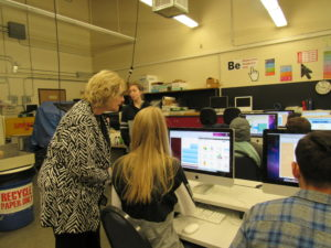 Board Member, former teacher, Laurel Leidner gets a graphics lesson from student