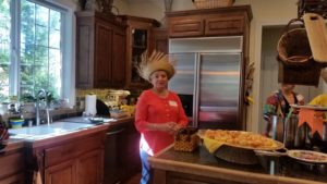 Ginny Durand helps serve Brazillian dishes at the beautiful Berman home