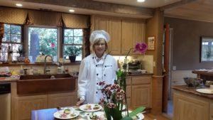 Sue Meeks serves guests Greek delights