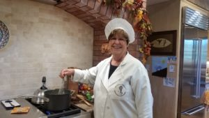 Pat Enterrios prepares sauce for Greek dish