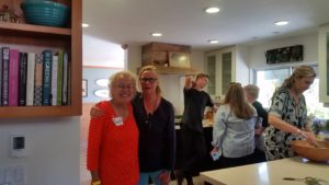 Cheryl Moxley and Nancy Corett in the busy Corett Kitchen